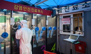 A man speaks to a nurse during a Covid-19 test at a testing booth outside Yangji hospital in Seoul.