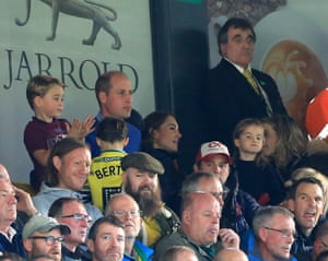 Prince George of Cambridge, Prince William, Duke of Cambridge and Catherine, Duchess of Cambridge are seen in the stands.