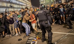 Spanish police clash with protesters during a demonstration at El Prat airport, on the outskirts of Barcelona on Monday.