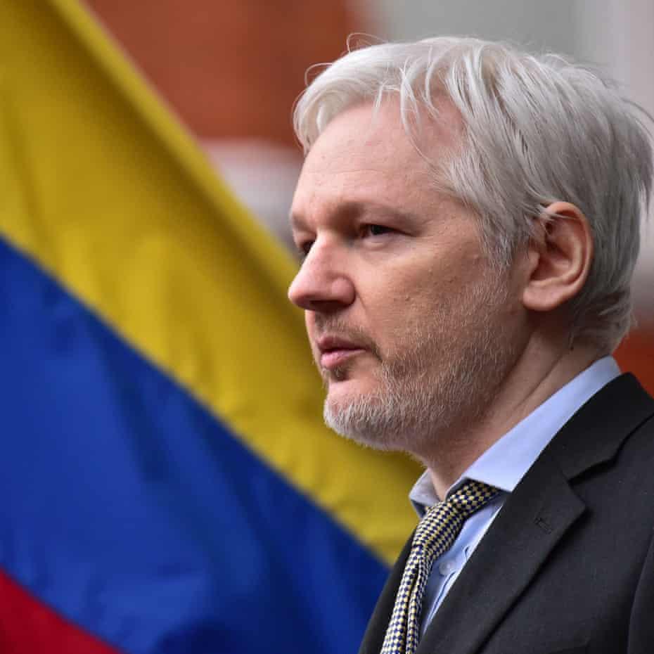 Julian Assange in front of an Ecuadorian flag