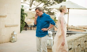 Hugh Laurie as Roper and Elizabeth Debicki as Jed on location at the Maricel Hotel and Spa, Mallorca, in a scene from TV show The Night Manager