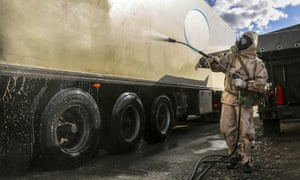 A Revolutionary Guard member disinfects a truck to help prevent the spread of the new coronavirus in the city of Sanandaj, western Iran.