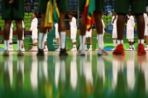 BaThe United States and Senegal line up prior to a women's preliminary round basketball game.