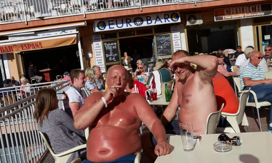 British tourists and expats at an outdoor bar in Benalmádena on the Costa del Sol.