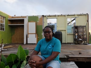 Knacynthar Nedd, leader of the Barbuda council, sits on the doorstep of a house that lost two walls and its roof
