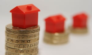 Monopoly houses on stacks of pound coins