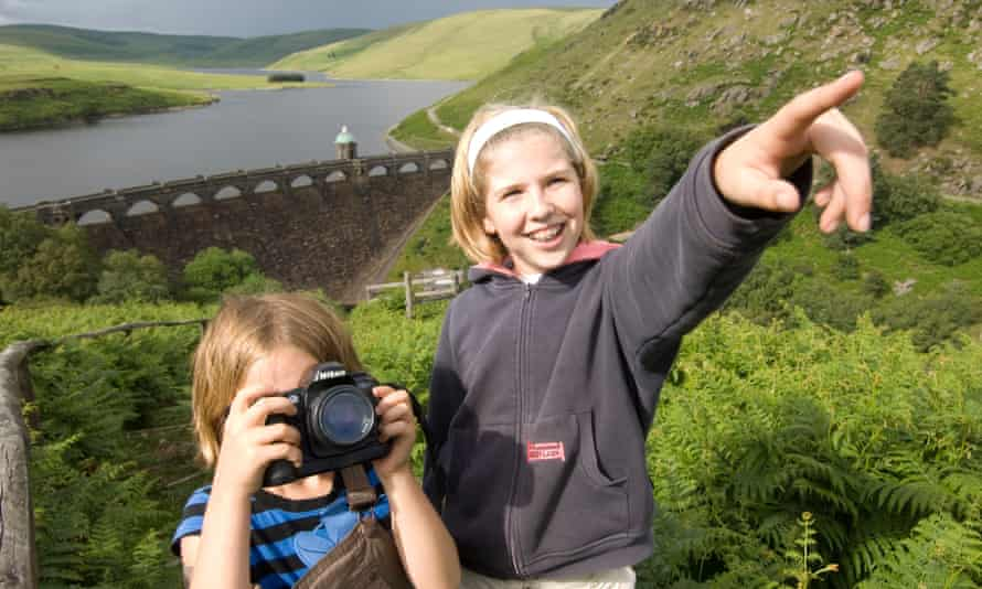 two young girls photographing at Graig Goch resevoir and dam