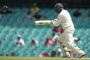 Australia's Usman Khawaja plays watchfully through gully.