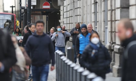 Commuters walk along Victoria Station in the first day of easing the lockdown rules in London, England on May 13.
