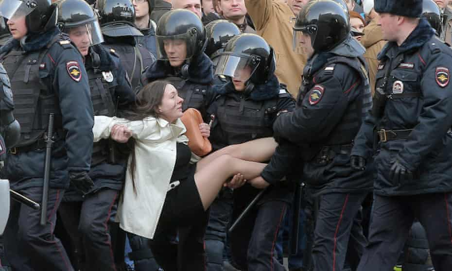 Russian riot police detain an anti-corruption demonstrator in central Moscow last month.
