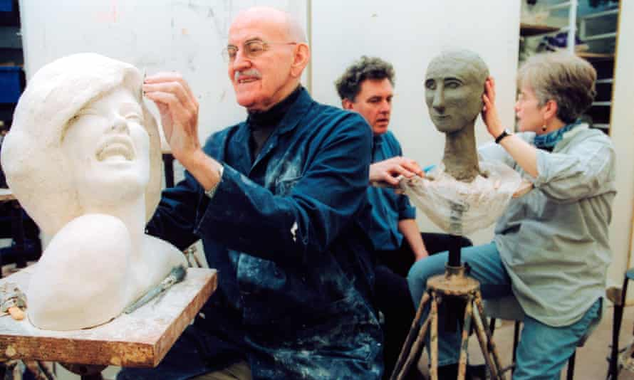 Adult Education students in a pottery/sculpture class with tutor at the Mary Ward Centre in London
