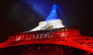 The Eiffel Tower is illuminated in the French national colours after the attacks in Paris this week.