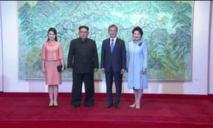 North Korean leader Kim Jong Un and first lady Ri Sol Ju, South Korean President Moon Jae-in and first lady Kim Jung-sook pose for photos during the inter-Korean summit at the truce village of Panmunjom