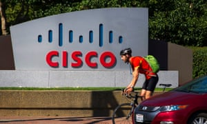 Cisco sign and man on bike