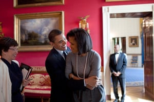 The president hugs First Lady Michelle Obama in the Red Room