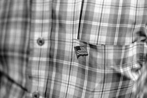 A man wears an American flag pin as he arrives for prayers at the Muslim American Society in Brooklyn, New York