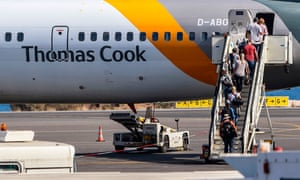 Tourists board a Thomas Cook plane in Heraklion, Crete