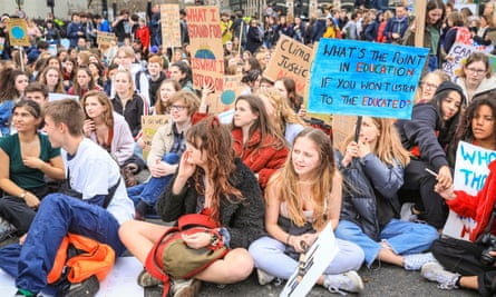 Young people take part in a protest against climate change, London, March 2019