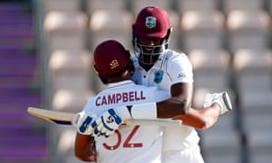 The West Indies capain Jason Holder celebrates with John Campbell after the winning runs were scored.