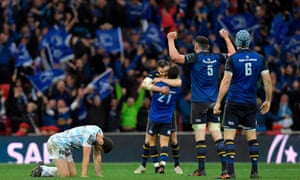 Racing 92's fly-half Remi Tales reacts as Leinster's players celebrate after winning the 2018 European Champions Cup final.