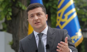 Volodymyr Zelenskiy gestures during an open-air news conference in Kyiv on May 20, 2020