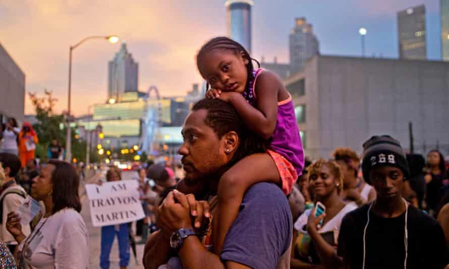 J'hiana Jlapion, Jabari JlapionFILE - J'hiana Jlapion, 4, sits on the shoulders of her father Jabari Jlapion during a protest in Atlanta on Monday, July 15, 2013 of George Zimmerman's not guilty verdict in the 2012 shooting death of teenager Trayvon Martin. (AP Photo/David Goldman)
