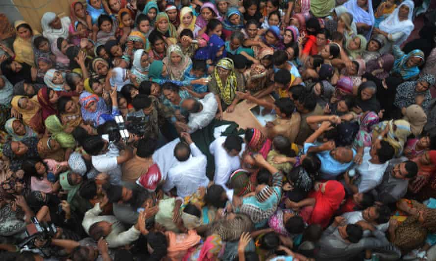 People gather around the coffin of a Pakistani soldier killed near the Pakistan-India border in Kashmir
