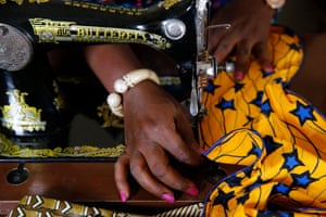 Chrystelle Oga using a sewing machine