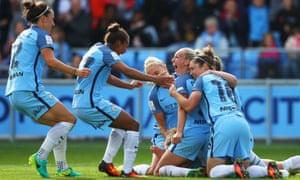 Toni Duggan celebrates scoring City's second goal with team mates.