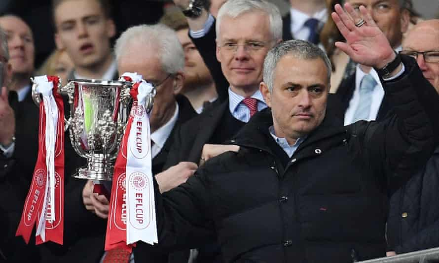 José Mourinho poses with the League Cup after guiding Manchester United to the trophy in February 2017. He is seeking to win it for a record fifth time with Spurs this season