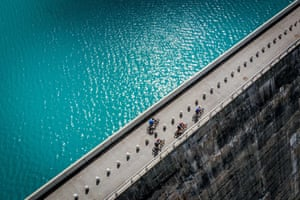 Haute-Nendaz, SwitzerlandMountain bikers ride between milk cans lined up on the top of the Cleuson dam during a land art installation by French-Swiss photographer Gerard Benoit a la Guillaume