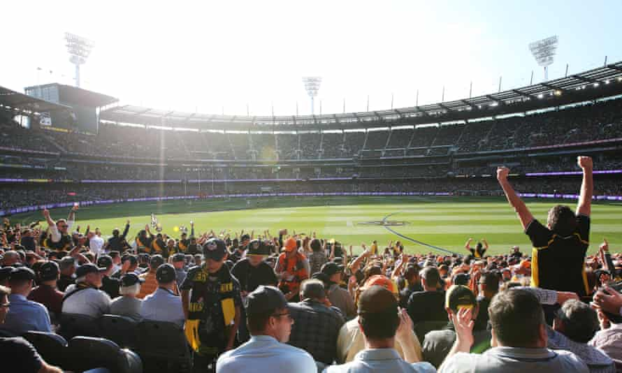 The crowd cheers at the 2019 AFL grand final between the Richmond Tigers and the GWS Giants at the MCG in Melbourne