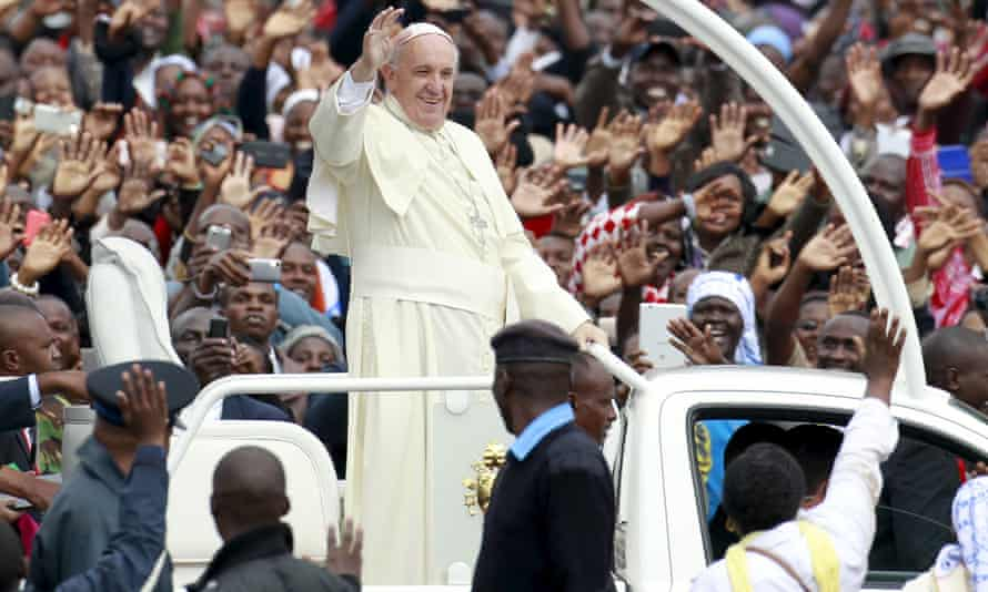 Pope Francis waves to the faithful as he arrives for a Papal mass in Nairobi in November 2015