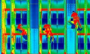 Infrared thermovision image three climbers washing office windows