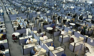 Call centre workers in their cubicles