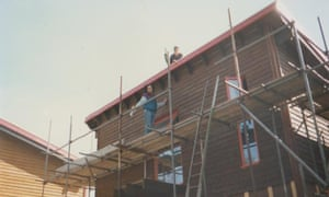 Two self-builders work on the roof of one of the houses in Nubia Way in 1995/1996.