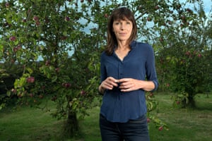 Rachel Cusk in front of an apple tree at her home in Norfolk, England.