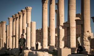 A Syrian defence force soldiers seen at the Temple of Bel, is an ancient stone ruin in Palmira, Syria