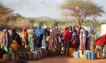 Women collect water at the New Kabasa camp for internally displaced people in northern Somalia, 2018