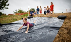 'Councils in England closed 214 playgrounds in just two financial years, and there are plans to close a further 234': children play at Quayplay in Flintshire, Wales.