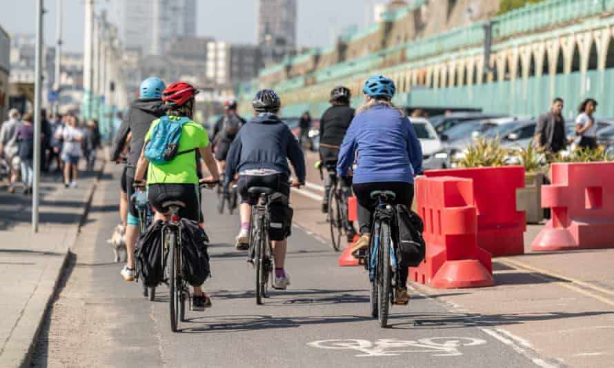 Cyclists on a new wider cycle lane on Madeira Drive, Brighton.