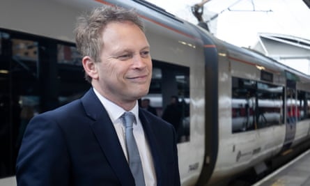 Grant Shapps next to a Northern-run train in Leeds station, the government is set to renationalise the services