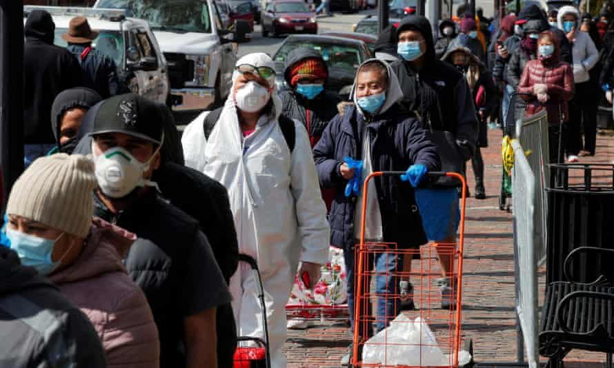 Outbreak of the coronavirus disease (COVID-19) in MassachusettsNelly Avila, wearing personal protective equipment, waits in a line for a pop-up food pantry amid the coronavirus disease (COVID-19) outbreak in Chelsea, Massachusetts, U.S., April 17, 2020. REUTERS/Brian Snyder