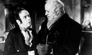 Mervyn Johns as Bob Cratchit and Alastair Sim as his employer in the 1951 version of Scrooge.