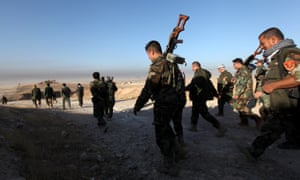 Peshmerga forces walk in the east of Mosul during operation to liberate the city from Isis.