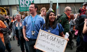 Protesters shout slogans during a demonstration outside the Conservative party conference in Manchester.