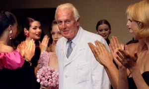 Givenchy is applauded by his models after presenting his final High Fashion collection in 1995.