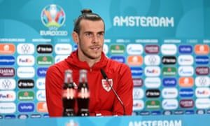 Gareth Bale of Wales speaks to the media on Friday afternoon. Fizzy drinks out of focus.
