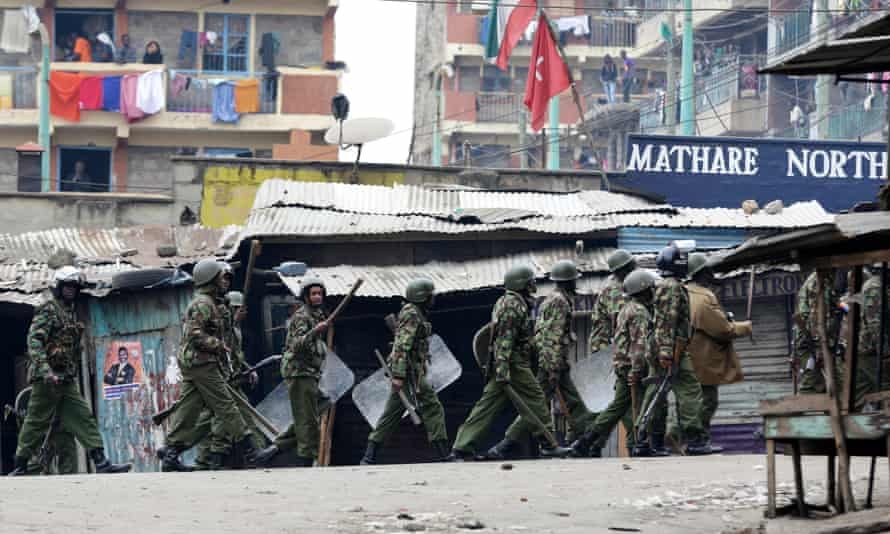 Riot police patrol the streets of Mathare North, Nairobi
