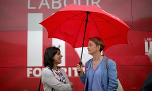 Labour MPs Shabana Mahmood and Yvette Cooper MP chat under the cover of an umbrella as Labour's Women In For Britain campaign in the West Midlands.